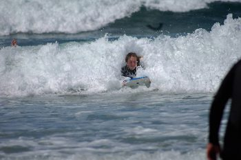 Bodyboarding at the beach near Hillside Cottage Padstow